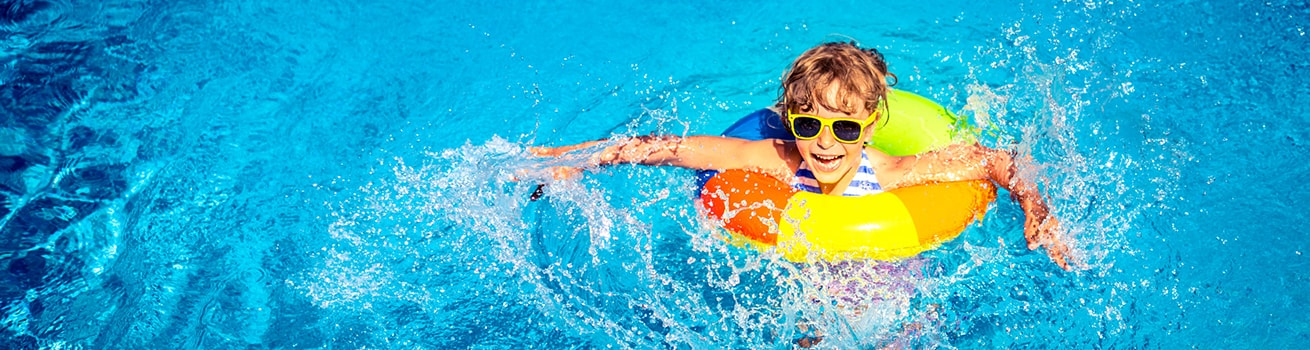 kid with pool float enjoying heated pool