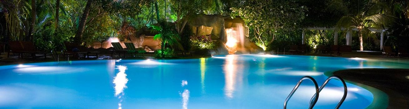 heated swimming pool with waterfall